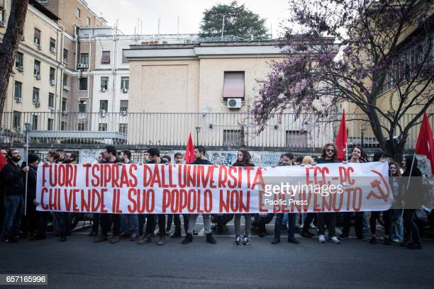 A demonstrators holding a banner reading 'Who sold his people is not welcomed Tsipras out of the University' as they shout slogans against the...
