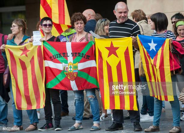Demonstrators holding Basque and Catalan flags take part in a demonstration to support the Catalan referendum for October 1 and against the arrest of...