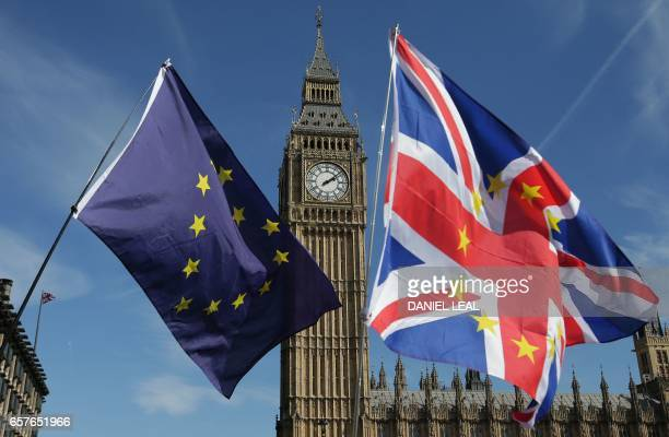 Demonstrators holding EU and Union flags gather in front of the Houses of Parliament in Parliament Square following an anti Brexit proEuropean Union...
