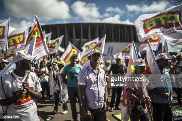 Demonstrators holding flags gather during protests outside of the National Congress demanding the resignation of President Michel Temer in Brasilia...
