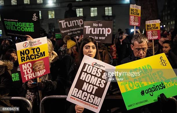 Demonstrators holding placards attend a protest outside Downing Street against US President Donald Trump's ban on travel from seven Muslim countries...