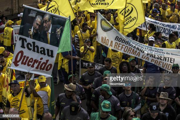 Demonstrators holding signs and banners gather during protests outside of the National Congress demanding the resignation of President Michel Temer...