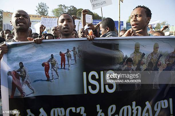 Demonstrators holds a banner during a rally after more than 20 Ethiopians Christians were killed by Islamic State militants on April 22 2015 in Addis...