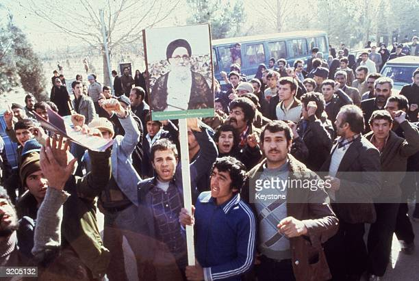 Demonstrators in Teheran calling for the replacement of the Shah of Iran during the Iranian Revolution They carry placards depicting Ayatollah...