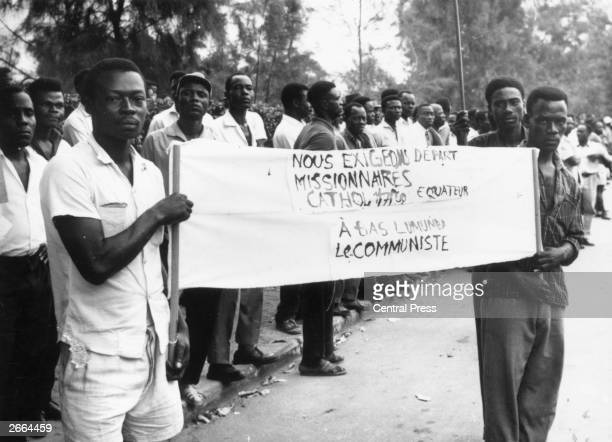 Demonstrators in the Belgian Congo protest against Congolese National Movement leader Patrice Lumumba the day before the country gained its...