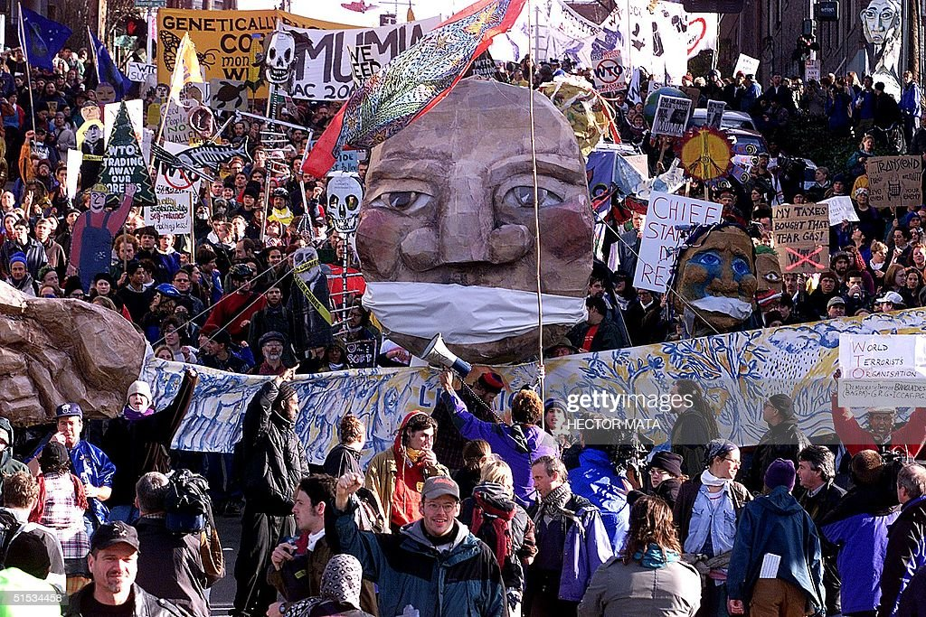 Demonstrators in the streets of Seattle protest the World Trade Organization summit 02 December 1999 A curfew imposed after violent demonstrations 30...