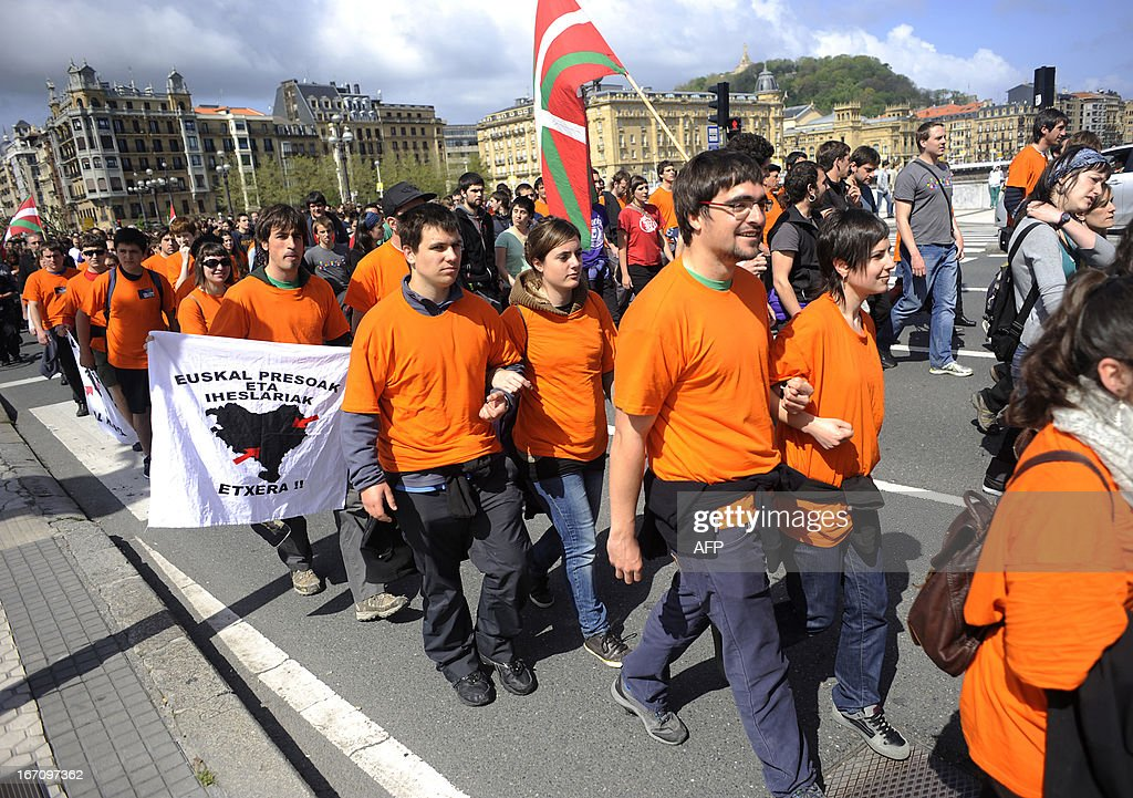 Demonstrators, including alleged members of various Basque pro-independence organizations, some of whom are facing trials, take part in a march against the arrest of eight members of the Basque pro-independence youth organization SEGI in the northern Spanish Basque city of San Sebastian on April 20, 2013. Hundreds of people took part in the march from the 'Askegunea' square, where six members of SEGI were arrested on April 19, to Martutene's prison in San Sebastian. Spain's supreme court sentenced SEGI's members Mikel Arretxe, Imanol Vicente, Naikari Otaegi, Egoi Alberdi, Aitor Olaizola, Adur Fernandez, Oier Lorente y Ekaitz Ezkerra to six years in jail on April 8 for membership in an organized armed group.