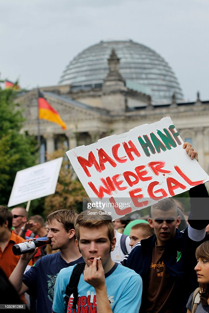 Demonstrators, including one who is carrying a sign that reads: 'Make Hemp Legal Again,' march past the Reichstag in support of the legalization of marijuana in Germany during the annual Hemp Parade, or 'Hanfparade', on August 7, 2010 in Berlin, Germany. The consumption of cannabis in Germany is legal, though all other aspects, including growing, importing and selling it, are not. However, since the introduction of a new law in 2009, the sale and possession of marijuana for licenced medicinal use is legal.