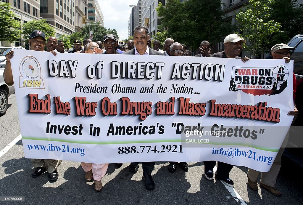 Demonstrators, including Reverend Jesse Jackson (C), rally in protest calling on US President Barack Obama to end the so-called 'War on Drugs,' which they say leads to mass incarceration of African Americans, as well as wanting additional investment in jobs and economic development in urban inner-city neighborhoods, during a 'Day of Direct Action' march through the streets of Washington on June 17, 2013, en route to Lafayette Park adjacent to the White House. AFP PHOTO / Saul LOEB