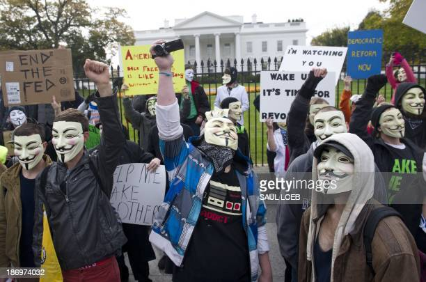 Demonstrators including supporters of the group Anonymous march in a protest against corrupt governments and corporations in front of the White House...