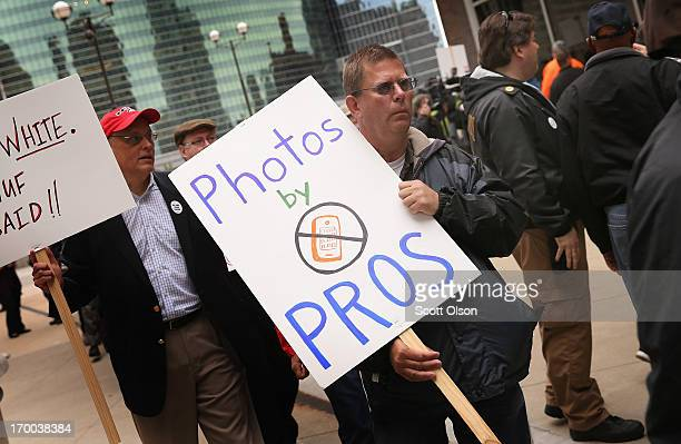 Demonstrators including union members reporters and photographers march outside the offices of the Chicago SunTimes protesting the newspapers...