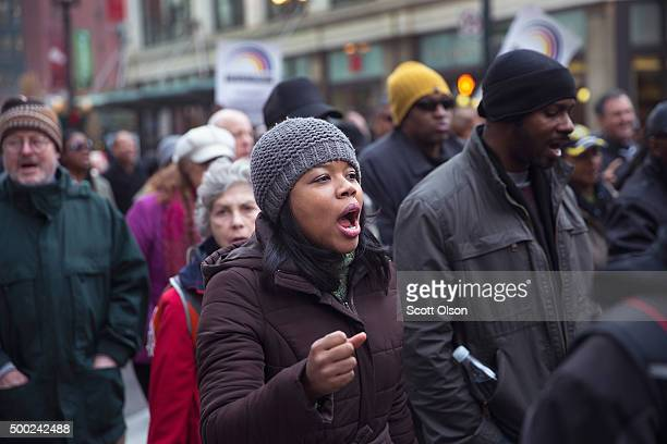 Demonstrators led by Rev Jesse Jackson march down State Street to protest the death of Laquan McDonald and the alleged coverup that followed on...