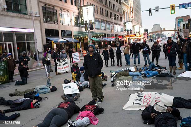 Demonstrators lie down on Euclid Ave at 14th Street to protest police violence December 20 in Cleveland Ohio