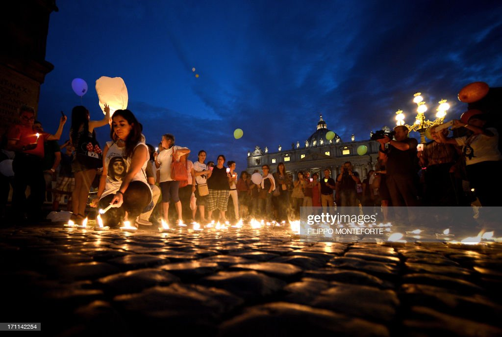 Demonstrators light candels as they commemorate the 30th anniversary of Emanuela Orlandi disappearance in Saint Peter's Square at the Vatican on June 22, 2013. Fifteen-year-old Emanuela Orlandi, the daughter of a Vatican messenger who lived with his family in Vatican City, disappeared on June 22, 1983 when she went to a music lesson. The still unsolved Orlandi saw over the years a number of theories regarding the motives for the crime from claimes that the kidnapping was done by extremist Muslim terrorists to demand the release of Mehmet Ali Agca from prison after he shot pope John Paul II to latest exorcist Gabriele Amorth claiming that she was kidnapped by a member of the Vatican police for sex parties, and then murdered. AFP PHOTO/ Filippo MONTEFORTE