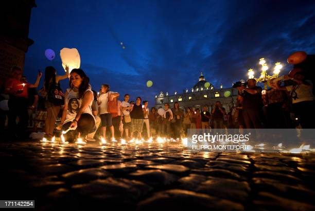 Demonstrators light candels as they commemorate the 30th anniversary of Emanuela Orlandi disappearance in Saint Peter's Square at the Vatican on June...