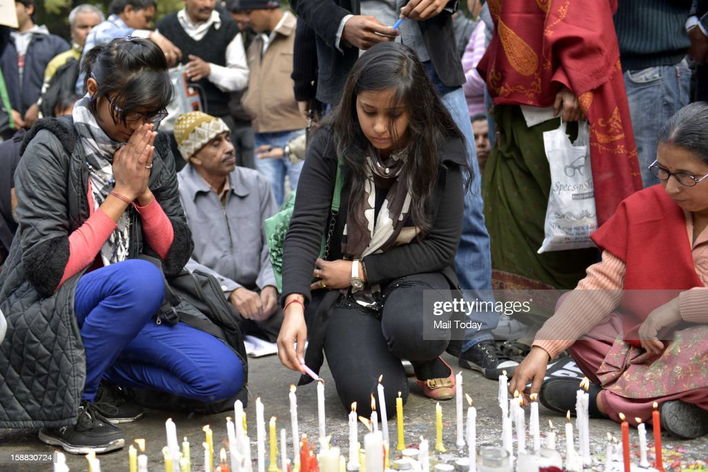 Demonstrators light candle in memory of gang rape victim in New Delhi December 30, 2012. The body of a woman whose gang rape provoked protests and a national debate about violence against women in India arrived back in New Delhi early on Sunday and was quickly cremated at a private ceremony.