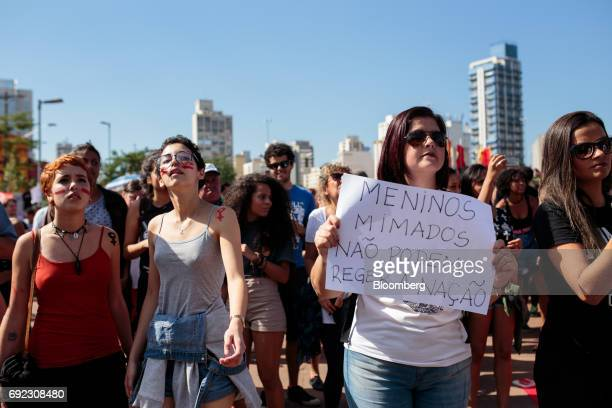 Demonstrators listen as musicians play on a platform during a protest against Brazilian President Michel Temer and government corruption at Largo da...