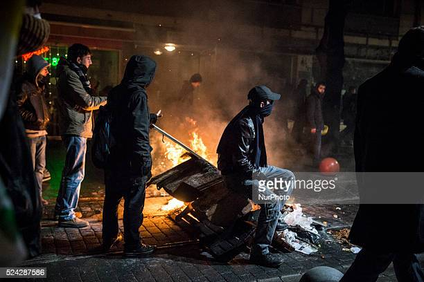 Demonstrators lit fires and clashed with police during a protest on February 25 2014 against corruption following the release of tapped phone...
