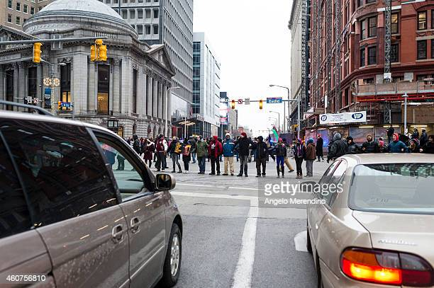 Demonstrators lock arms and block traffic at Euclid and 9th Street December 21 in Cleveland Ohio Protestors gathered to voice opposition to excessive...