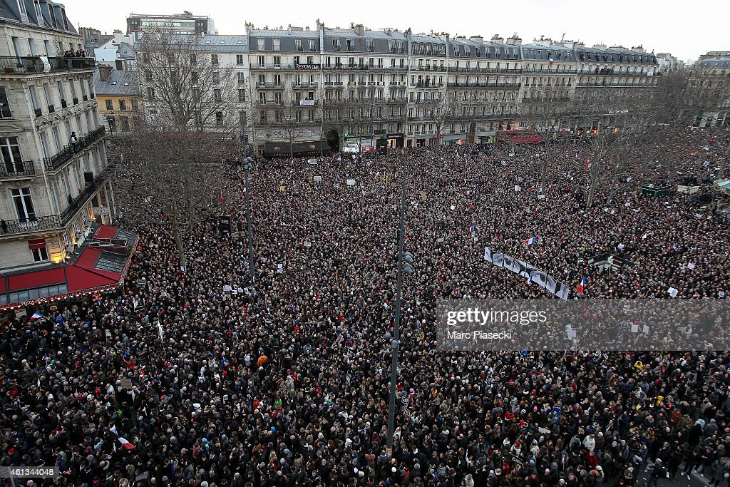 Demonstrators make their way along 'Place de la Republique' in a unity rally in Paris following the recent terrorist attacks on January 11, 2015 in Paris, France. An estimated one million people are expected to converge in central Paris for the Unity March joining in solidarity with the 17 victims of this week's terrorist attacks in the country. French President Francois Hollande will lead the march and will be joined by world leaders in a sign of unity. The terrorist atrocities started on Wednesday with the attack on the French satirical magazine Charlie Hebdo, killing 12, and ended on Friday with sieges at a printing company in Dammartin en Goele and a Kosher supermarket in Paris with four hostages and three suspects being killed. A fourth suspect, Hayat Boumeddiene, 26, escaped and is wanted in connection with the murder of a policewoman. on January 11, 2015 in Paris, France.