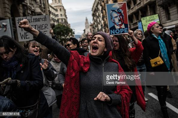 Demonstrators make their way during the Women's March on January 21 2017 in Barcelona Spain The Women's March originated in Washington DC but soon...