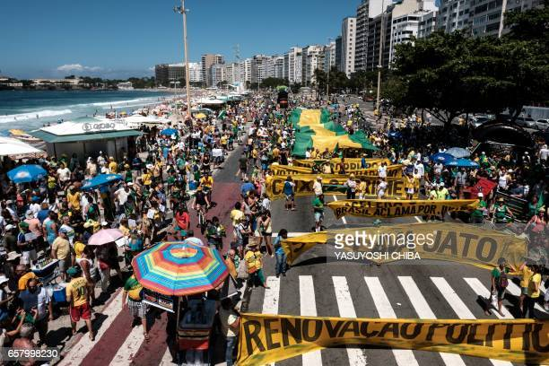 Demonstrators march along Copacabana Beach in Rio de Janeiro Brazil on March 26 2017 during a nationwide protest against political corruption / AFP...