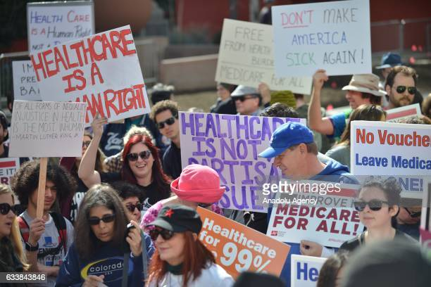 Demonstrators march and rally to protest against President Donald Trump's and the GOP's race to repeal and replace the Affordable Care Act at Los...