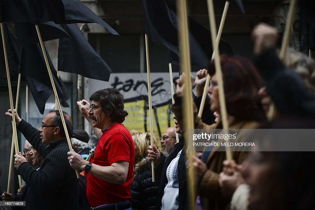 Demonstrators march and shout slogans during a demonstration called by the unions Common Front, CGTP (General Confederation of the Portuguese Workers) and STAL (National Union of the Local and Regional Public Workers) against the austerity measures of the Portuguese government in Lisbon on March 15, 2013. Today the Finance Minister, Vitor Gaspar, said that the GDP (Gross Domestic Product) will drop 2.3%, that unemployment might reach 19% and the adjustment effort will have to continue for decades.' AFP PHOTO/ PATRICIA DE MELO MOREIRA