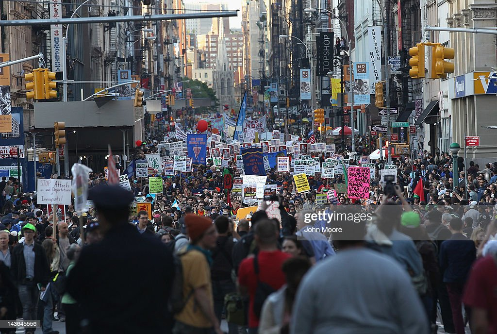 Demonstrators march down Broadway during a May Day protest on May 1, 2012 in New York City. Occupy Wall Street demonstrators joined labor groups in a march to protest economic injustice and observe International Labor Day.