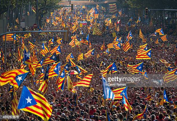 Demonstrators march during a ProIndependence demonstration as part of the celebrations of the National Day of Catalonia on September 11 2014 in...