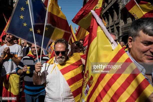 Demonstrators march during a protest against Catalonia's indepedence on October 8 2017 in Barcelona Spain Large numbers of citizens are expected to...
