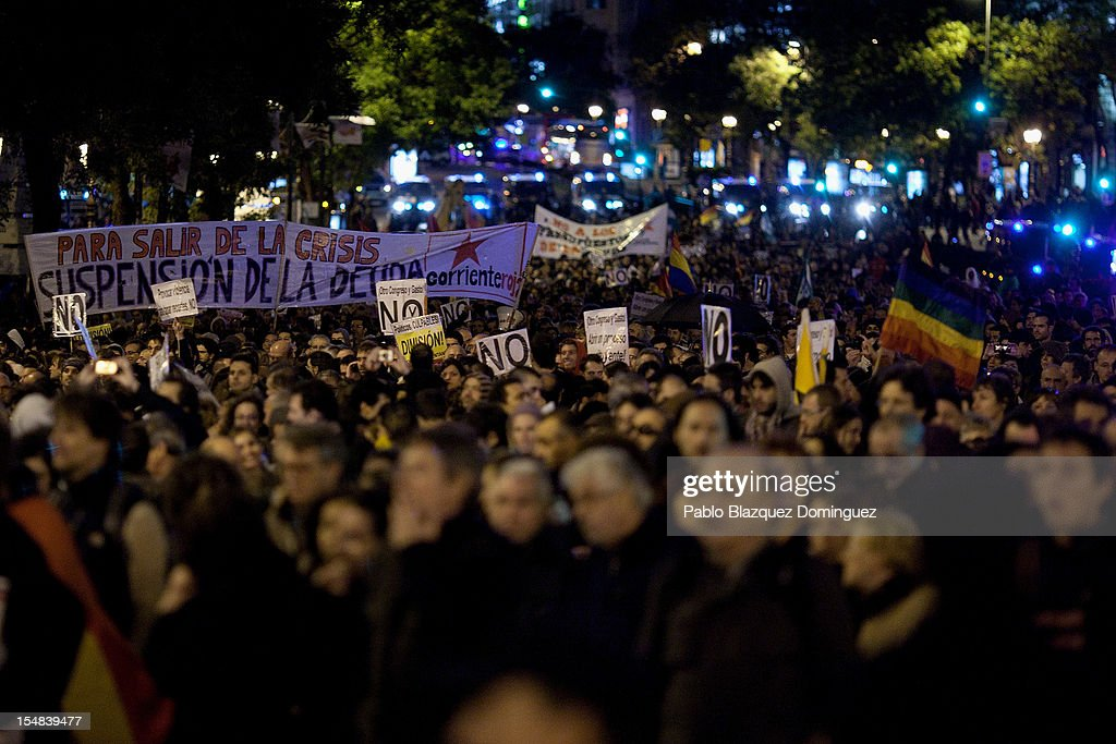 Demonstrators march during a protest against spending cuts and the government of Mariano Rajoy on October 27, 2012 in Madrid, Spain. Demonstrators are protesting near the Spanish Parliament against the government's austerity measures. With the economic crisis tightening it's grip, Spain is in its second recession in three years, Rajoy's governement is presssured more and more to seek aid that can easy their debts.