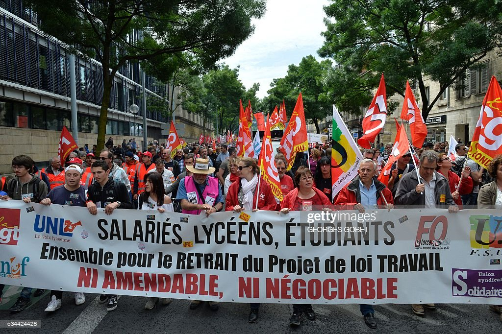 Demonstrators march during a protest called by seven labour unions and students against labour and employment law reform on May 26, 2016 in Bordeaux, southwest France. Fresh rallies were due to be held May 26 in Paris and other cities in the latest bout of social unrest that started three months ago and has frequently turned violent. Under intense pressure, Prime Minister Manuel Valls vowed the labour law would not be withdrawn, but said it might still be possible to make 'changes' or 'improvements'. / AFP / GEORGES