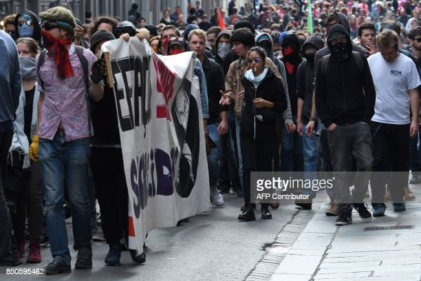 Demonstrators march during a rally in Rennes on September 21 held to protest the French government's proposed reforms in labour laws / AFP PHOTO /...