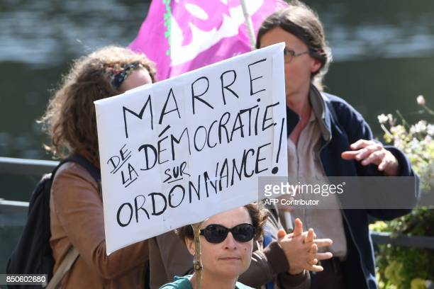 Demonstrators march during a rally in Rennes on September 21 held to protest the French government's proposed reforms in labour laws 'Enough of the...