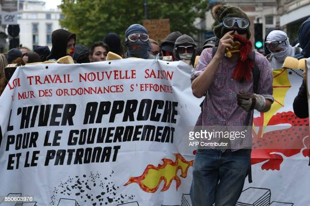 Demonstrators march during a rally in Rennes on September 21 held to protest the French government's proposed reforms in labour laws 'Labour law new...