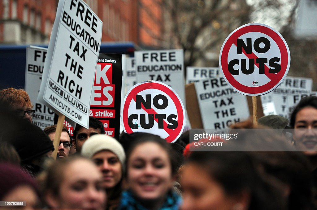 Demonstrators march during a student rally in central London on November 21, 2012 against sharp rises in university tuition fees, funding cuts and high youth unemployment.