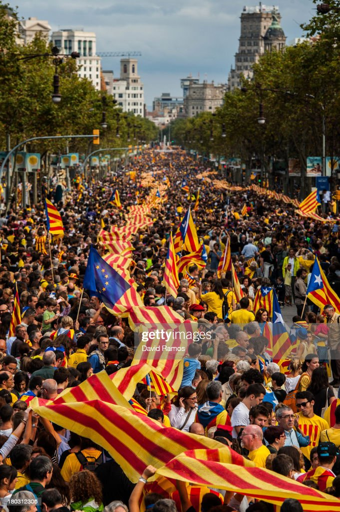 Demonstrators march during The National Day of Catalonia on September 11 2013 in Barcelona Spain Thousands of Catalans celebrating the 'Diada...