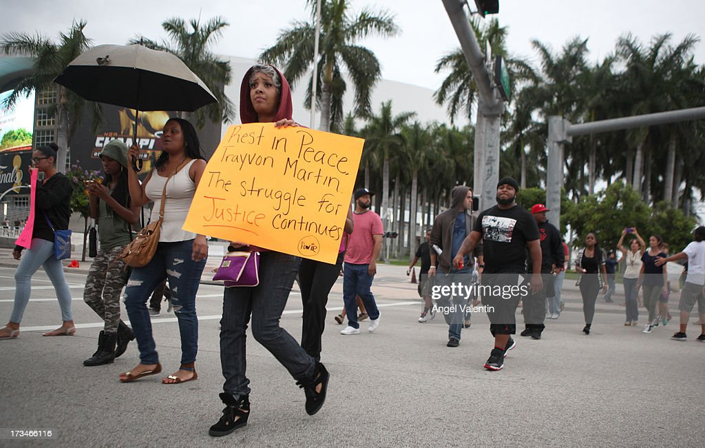 Demonstrators march following a peaceful rally at the Torch of Freedom in downtown Miami a day after the verdict to the George Zimmerman murder trail on July 14, 2013 in Miami, Florida. A jury found neighborhood watch volunteer, George Zimmerman not guilty of shooting and killing 17-year-old Trayvon Martin after an altercation in February 2012.