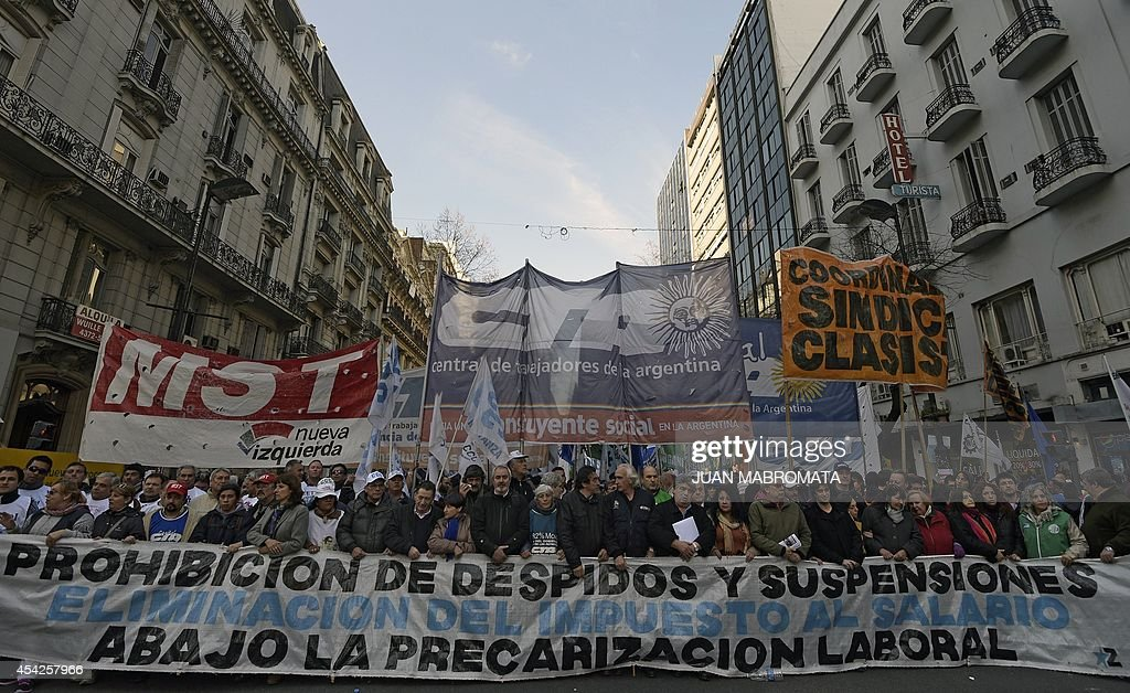 Demonstrators march from Plaza de Mayo square to the Congress building demanding the government to protect employment in Buenos Aires on August 27 on...