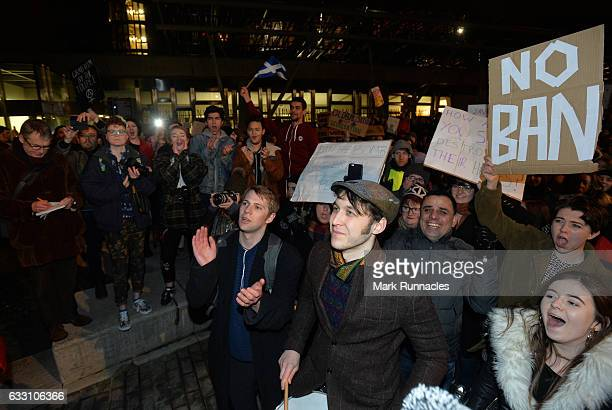 Demonstrators march from the Mound to the Scottish Parliament to protest against President Trump's Muslim travel ban to the USA on January 30 2017 in...