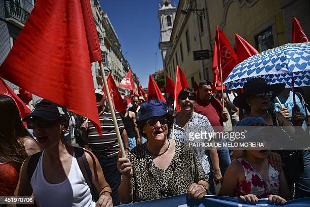 Demonstrators march holding flags during a demonstration called by the CGTP union against the austerity measures of the Portuguese government in...