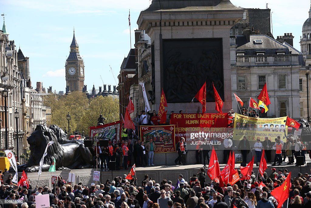 Demonstrators march in a May Day rally in London on May 1, 2016. / AFP / JUSTIN