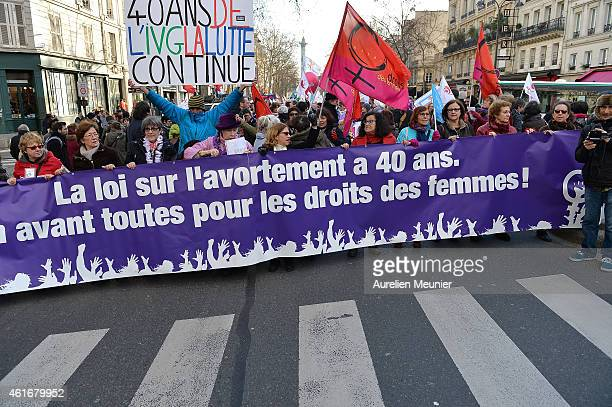 Demonstrators march in a rally to defend women's rights on January 17 2015 in Paris France Thousands of people walked together from Place de la...