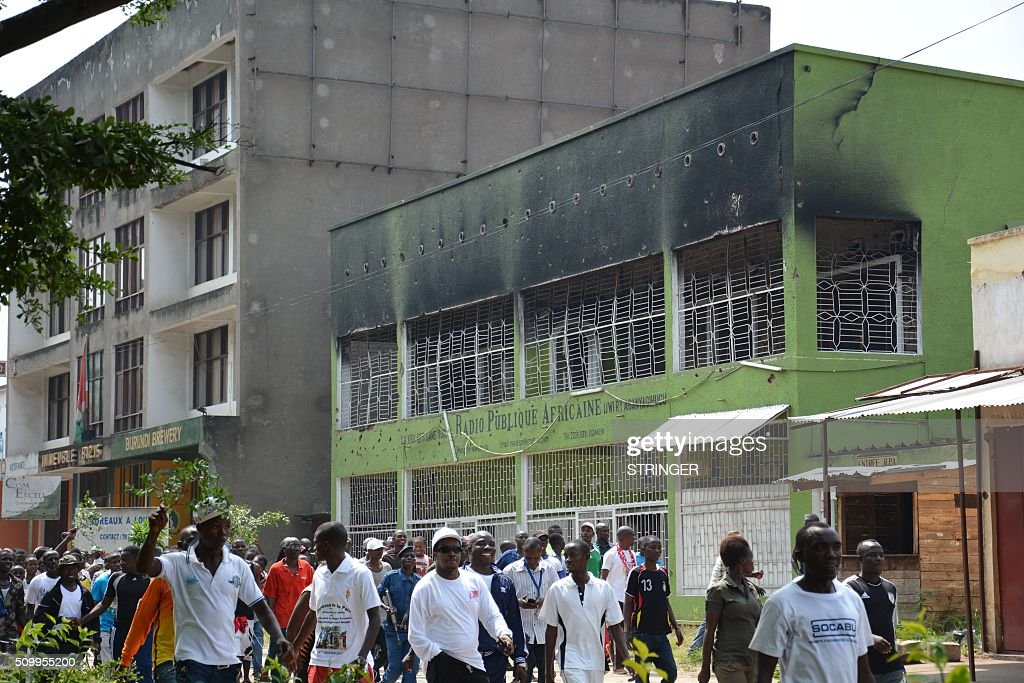 Demonstrators march on February 13, 2016 in Bujumbura during a protest against Rwanda, in front of the building of the radio RPA burnt on may 2015 during the failed coup. Rwanda is to relocate refugees from Burundi to other countries, amid accusations Kigali was meddling in the affairs of its troubled neighbour. UN experts told the Security Council that Rwanda has recruited and trained refugees from Burundi, among them children, who wanted to remove Burundi's President Pierre Nkurunziza from power. Burundi has repeatedly accused Rwanda of backing rebels intent on overthrowing the government in Bujumbura. Kigali has fiercely denied the accusations. Burundi has been in turmoil since Nkurunziza announced plans in April to run for a third term, which he went on to win. Hundreds of people have been killed and at least 230,000 have fled the country. Some 75,000 Burundian refugees are in Rwanda, according to the UN refugee agency, UNHCR. / AFP / STRINGER