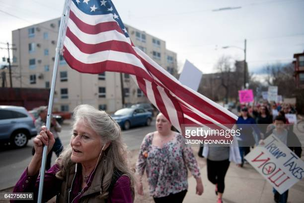 Demonstrators march on February 18 2017 to the First Unitarian Church in Denver Colorado where Jeanette Vizguerra an undocumented Mexican mother of...