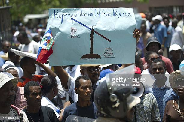 Demonstrators march on May 6 in PortauPrince to denounce impunity and corruption plaguing the Haitian judicial system Civil society organizations...