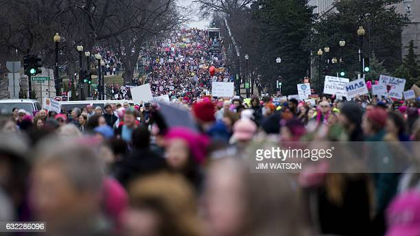 Demonstrators march on the National Mall in Washington DC for the Women's march on January 21 2017 Hundreds of thousands of protesters spearheaded by...