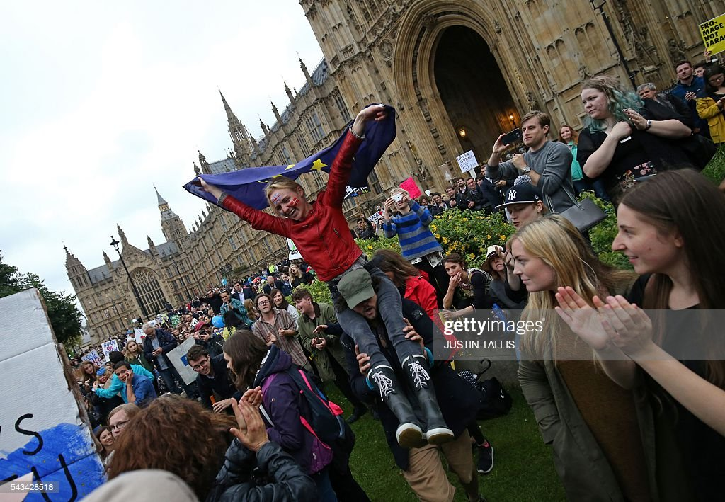 Demonstrators march onto College Green outside The Houses of Parliament at an anti-Brexit protest in central London on June 28, 2016. EU leaders attempted to rescue the European project and Prime Minister David Cameron sought to calm fears over Britain's vote to leave the bloc as ratings agencies downgraded the country. Britain has been pitched into uncertainty by the June 23 referendum result, with Cameron announcing his resignation, the economy facing a string of shocks and Scotland making a fresh threat to break away. / AFP / JUSTIN