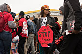 Demonstrators march past a McDonald's Corp restaurant during a rally in Oak Brook Illinois US on Wednesday May 20 2015 Labor activists seeking...